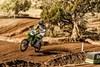 KX™100 riding left on course