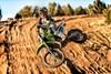 KX™100 rider jumping